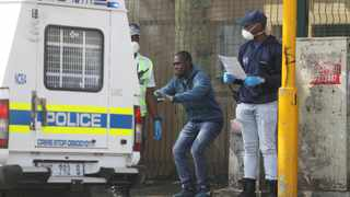Police in Durban CBD punish a man who allegedly flouted lockdown regulations by making him do squats. Picture: Doctor Ngcobo/African News Agency(ANA)