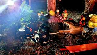 July 14 - One man was killed and three other people were seriously injured when the car they were travelling in left the M13 freeway while going up Fields Hill in Pinetown in Durban and crashed into a tree in the early hours of Sunday morning. Photo: Rescue Care