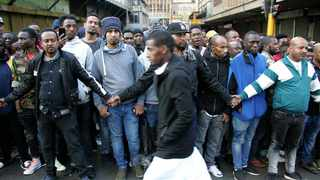Metro police and foreign nationals on Jeppe and Delvers streets as mayor Herman Mashaba arrived at the scene where South African Police Service officers were attacked by foreigners allegedly selling counterfeit goods in the Johannesburg CBD. File photo: ANA/Nhlanhla