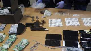 A couple aged 46 and 42 was arrested by the Anti-Gang Unit on Tuesday night when the members of the AGU pursued information of possible gang-related activities at a residence in Grand Vue Avenue in Elsies River. Picture: SAPS