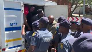 Police officers on Friday acted against refugees who had forcefully occupied theUnited Nations High Commissioner for Refugees'  premises in Brooklyn. Photo: Brenda Masilela/ANA