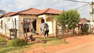 Residents and friends clean up the house were three women and four children were buried inside a house in Vlakfontein south of Johannesburg. Picture: Itumeleng English/African News Agency (ANA)