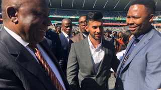 President Cyril Ramaphosa congratulates Durand Naidoo and Thuso Mhlambi, first black owners of a South African shipping company at the Youth Day event in Orlando Stadium. PHOTO: Supplied