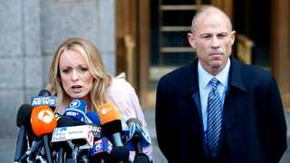 Adult film actress Stephanie Clifford, also known as Stormy Daniels, speaks to media along with lawyer Michael Avenatti outside court. Picture: Reuters/Brendan Mcdermid