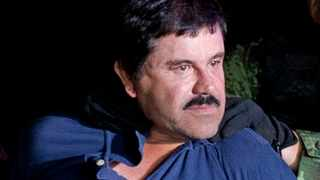"""Drug lord Joaquin """"El Chapo"""" Guzman is made to face the media in Mexico City as he is escorted by Mexican soldiers following his recapture six months after escaping from a maximum security prison in 2016. File picture: Eduardo Verdugo/AP"""