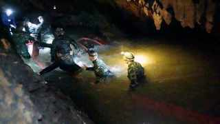 Thai rescue teams walk inside cave complex where 12 boys and their soccer coach went missing, in Mae Sai, Thailand. Picture: Tham Luang Rescue Operation Center via AP