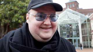 Megaupload founder Kim Dotcom talks to members of the media as he leaves the High Court in Auckland. File picture: Reuters