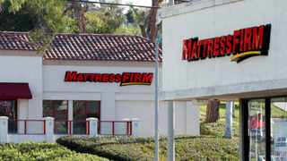 FILE PHOTO: Two Mattress Firm stores lie on either side of the street in Encinitas, California,