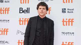 """Actor Jesse Eisenberg poses for photos at the red carpet for the premiere of the film """"The Hummingbird Project"""" during the 2018 Toronto International Film Festival in Toronto on Saturday, September 8, 2018. (Tijana Martin/The Canadian Press via AP)"""