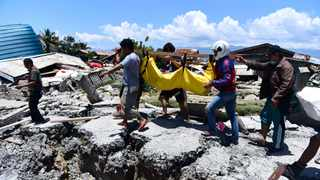 Indonesian authorities scrambled to get aid and rescue equipment into quake-hit Sulawesi island, and prepared to bury some of the at least 832 dead. Picture: AP Photo/Arimacs Wilander, File