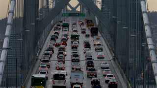 FILE - In this Dec. 10, 2015, file photo, vehicles make their way westbound on Interstate 80 across the San Francisco-Oakland Bay Bridge as seen from Treasure Island in San Francisco. Junkyard palladium is quickly becoming a growth market as mined supplies of the silvery-white metal used to control harmful car emissions run short.  (AP Photo/Ben Margot, File)