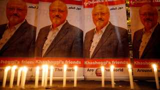Candles, lit by activists, protesting the killing of Saudi journalist Jamal Khashoggi, are placed outside Saudi Arabia's consulate, in Istanbul, during a candlelight vigil, Thursday, Oct. 25, 2018. On Friday, it was reported that Saudi Arabia's chief prosecutor will visit Istanbul to speak with Turkish authorities as part of the investigation into Khashoggi's murder. (AP Photo/Lefteris Pitarakis)