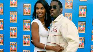 Sean P. Diddy Combs and his then-girlfriend Kim Porter (AP Photo/Nam Y. Huh, File)