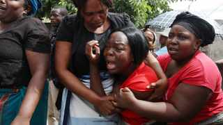 A family member of Kelvin Tinashe Choto reacts, during his funeral in Chitungwiza, about 30 kilometres south-east of Harare. Before Kelvin's family knew he had been killed, social media in Zimbabwe was circulating a photo of his battered body lying on the reception counter of a local police station. Picture: Tsvangirayi Mukwazhi/AP