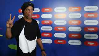 Ronaldinho appears in a video, recorded in a studio, wearing a black beret and a white tank top emblazoned with the image of Saint George slaying a dragon. Photo: Reuters