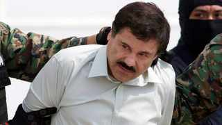 "Joaquin ""El Chapo"" Guzman, the head of Mexico's Sinaloa Cartel, being escorted to a helicopter in Mexico City following his capture in the beach resort town of Mazatlan. File picture: Eduardo Verdugo/AP"