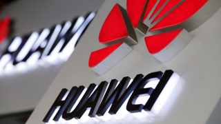 Logos of Huawei are pictured outside its shop in Beijing