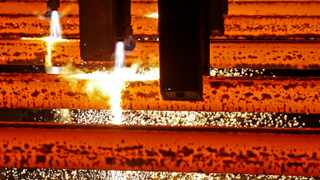 FILE PHOTO: Steel bars are seen during production at ArcelorMittal steel factory in Zenica