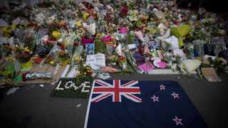 Mourners lay flowers on a wall outside the Al Noor mosque in Christchurch, New Zealand. Picture: Vincent Thian/AP