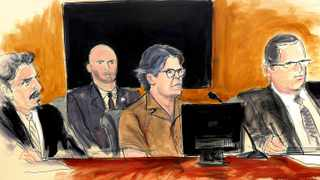 In this courtroom sketch Keith Raniere, second from right, leader of the secretive group NXIVM, attends a court hearing in the Brooklyn borough of New York. The spiritual leader of an upstate New York self-help group has pleaded not guilty to new charges accusing him of possessing child pornography. File picture: Elizabeth Williams via AP
