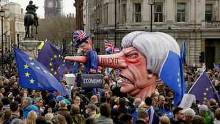 An effigy of British Prime Minister Theresa May is wheeled through Trafalgar Square during a Peoples Vote anti-Brexit march in London. Picture: Tim Ireland/AP