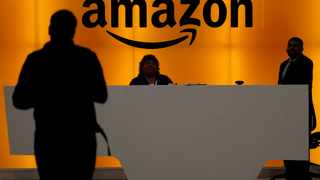Amazon.com has dismissed the idea of running a fully automated warehouse in the near future, citing the superior cognitive ability of humans and the limitations of current technology. Photo: Reuters