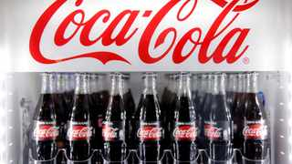 FILE PHOTO: Bottles of Coca-Cola are pictured in a cooler during a news conference in Paris. Global company Coca-Cola said on Sunday it was the only food and beverage brand ranked in the top five most admired brands.