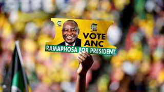 A supporter holds a placard with the face of ANC president Cyril Ramaphosa, during the party's final rally at Ellis Park Stadium in Johannesburg. File picture: Siphiwe Sibeko/Reuters