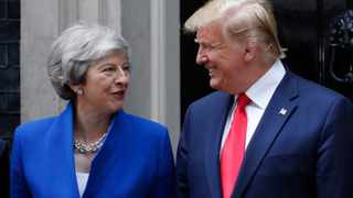 Britain's Prime Minister Theresa May welcomes President Donald Trump outside 10 Downing Street in central London. Picture: Alastair Grant/AP