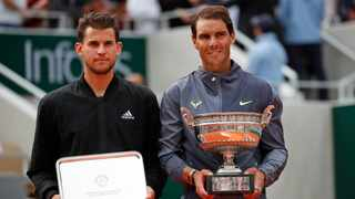 Spain's Rafael Nadal, right, holds the trophy as he celebrates his record 12th French Open tennis tournament title after winning his men's final match against Austria's Dominic Thiem, left, in four sets, 6-3, 5-7, 6-1, 6-1, at the Roland Garros stadium in Paris on Sunday. Photo: Christophe Ena/AP