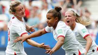 England's Nikita Parris celebrates scoring their first goal from the penalty spot with Ellen White, the scorer of the second goal. Photo: Eric Gaillard/Reuters
