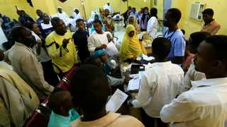 Relatives of victims of violence in the crackdown on Sudanese protesters listen to a doctor inside a ward in a hospital in Omdurman. Picture: Mohamed Nureldin Abdallah/Reuters