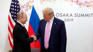US President Donald Trump, right, and Russian President Vladimir Putin greet each other during a bilateral meeting on the sidelines of the G-20 summit in Osaka, Japan. Picture: Mikhail Klimentyev, Sputnik, Kremlin Pool Photo via AP