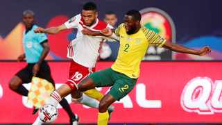 Morocco's Youssef En-Nesyri and South Africa's Buhle Mkhwanazi in a tussle for the ball. Photo: Amr Abdallah Dalsh/Reuters