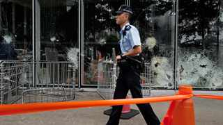 A police officer patrols outside the Legislative Council building in Hong Kong. Picture: Vincent Yu/AP