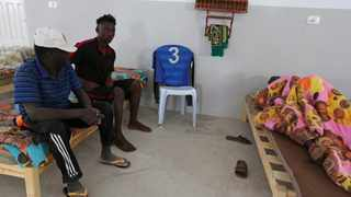 An African migrant (C), who was rescued after the boat he was travelling capsized in the Mediterranean Sea off the Tunisian Coast, sits inside a local Red Crescent chapter in Zarzis, Tunisia July 4, 2019. The boat sank after the group set out from Zuwara in Libya, the Red Crescent and government sources confirmed on Thursday. Photo: REUTERS/Stringer.