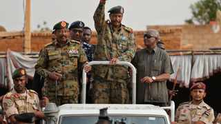 Sudanese Gen. Abdel-Fattah Burhan, head of the military council, waves to his supporters upon his arrival to attend a military-backed rally. Picture: AP Photo/Hussein Malla