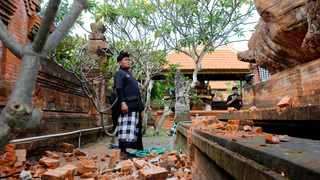 Indonesian authorities say a subsea earthquake shook Bali, Lombok and East Java, causing damage to homes and temples. Picture: Firdia Lisnawati/AP