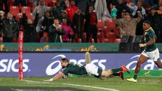 Cobus Reinach dives over to score the bonus-point try for the Springboks against the Wallabies. Photo: Mike Hutchings/Reuters