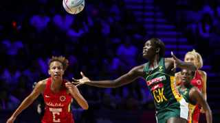 South Africa's Phumza Maweni and England captain Serena Guthrie, left, go for the ball during the Netball World Cup bronze medal match on Sunday. Photo: Rui Vieira/AP