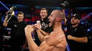 """In this 2018 file photo, Maxim Dadashev celebrates after defeating Antonio DeMarco during a junior welterweight bout in Las Vegas. On Saturday, doctors said Dadashev had surgery at a Maryland hospital for swelling on his brain after collapsing outside the ring after losing a match. Photo"""" John Locher/AP Photo"""