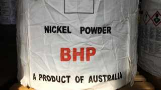 """A tonne of nickel powder made by BHP Group sits in a warehouse at its Nickel West division, south of Perth. Iron Ore futures yesterday slipped after BHP Group, which is listed on the JSE, forecast that iron ore supply in the longer-term was """"expected to return to a more normal trajectory""""."""