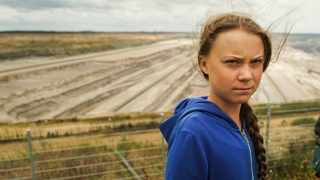 Climate activist Greta Thunberg stands in front of the open-cast lignite pit during a visit the ancient Hambach Forest near the city of Kerpen in western Germany. Picture: Mstyslav Chernov/AP