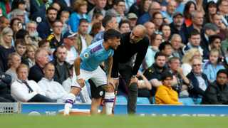 Manchester City's head coach Pep Guardiola, right, gives instructions to Manchester City's David Silva during the English Premier League soccer match between Manchester City and Tottenham Hotspur at Etihad stadium in Manchester, England, Saturday, Aug. 17, 2019. (AP Photo/Rui Vieira)
