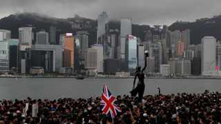 Thousands of protesters carrying the British flag march near the harbour of Hong Kong. Hong Kong police have confirmed it had received a report on August 9, 2019, about a British foreign ministry employee who has been missing since crossing into China on a business trip. File picture: Kin Cheung/AP