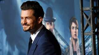 "Orlando Bloom quipped his son needs ""therapy"" to cope with his famous parenting team. Picture: AP"