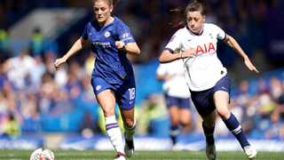 Chelsea's Maren Mjelde, left, and Tottenham Hotspur's Lucy Quinn battle for the ball during the Women's Super League soccer match at Stamford Bridge Photo: John Walton/PA via AP