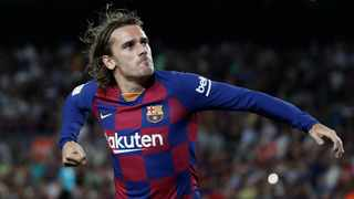 Barcelona's Antoine Griezmann celebrates after scoring the opening goal during the Spanish La Liga soccer match between FC Barcelona and Villarreal CF at the Camp Nou in September. Photo: AP Photo/Joan Monfort