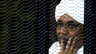 Sudan's former president Omar Hassan al-Bashir sits inside a cage at the courthouse in Khartoum where he appeared on corruption charges in September. File picture: Mohamed Nureldin Abdallah/Reuters
