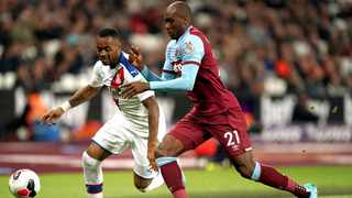 Crystal Palace's Jordan Ayew, left, and West Ham United's Angelo Ogbonna battle for the ball during their English Premier League match at London Stadium on Saturday. Photo: John Walton/AP
